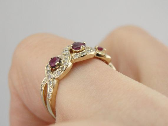 Gold and Ruby Band with Diamond Accents