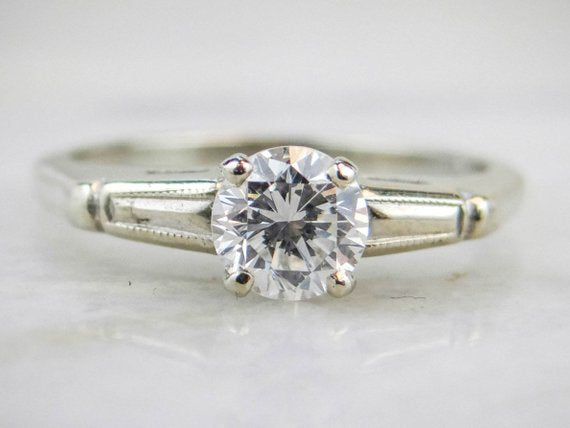 Round Brilliant Diamond With Simple Tapered Baguette Style Shoulders