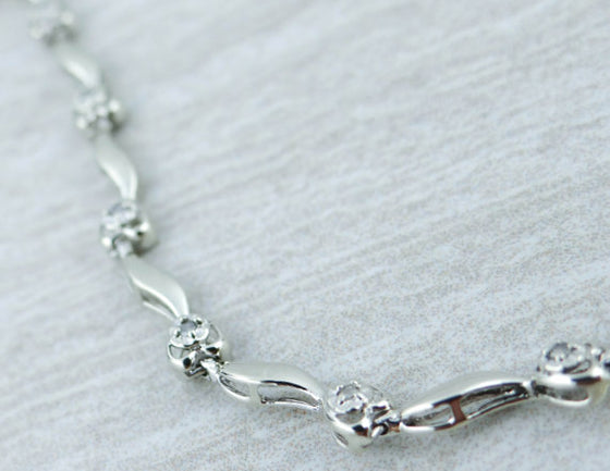 Sweet White Gold Heart Themed Bracelet with Diamonds