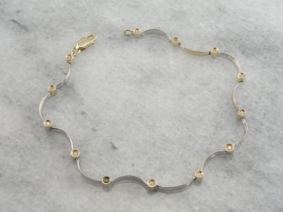 Sinuous White Gold and Diamond Bracelet with Yellow Gold Accents