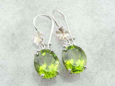Luscious Peridot Teardrop Earrings With Flower Accents in Fine White Gold
