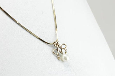 Love Knot: Symbolic Vintage Pendant for Bride or Bridesmaid