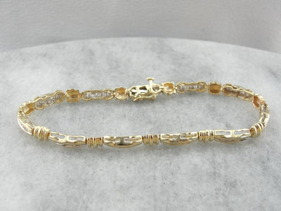 Baguette Channel Diamond Bracelet with Gleaming Gold Accents