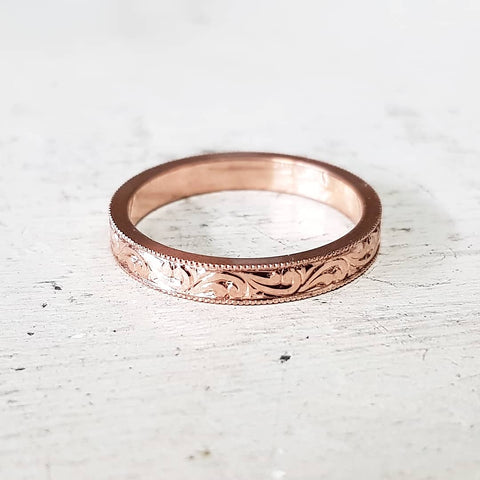 Scroll engraved ring