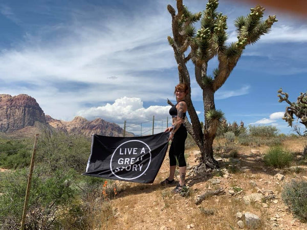 LIVE A GREAT STORY Adventure Inspiration Flag in Joshua Tree California
