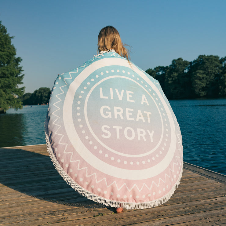 The LIVE A GREAT STORY Beach Towel