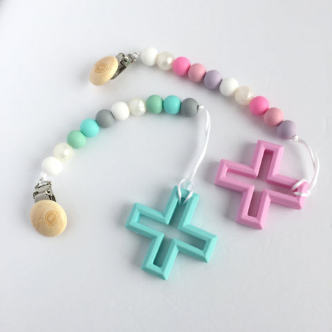 Silicone Cross Teether with Pacifier Clip - Blue or Pink - eggie baby