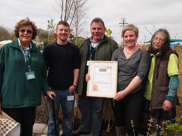 Seamus Collard, Maria Collard and Louise Amery receiving an award for the Best Plant Display at Fota