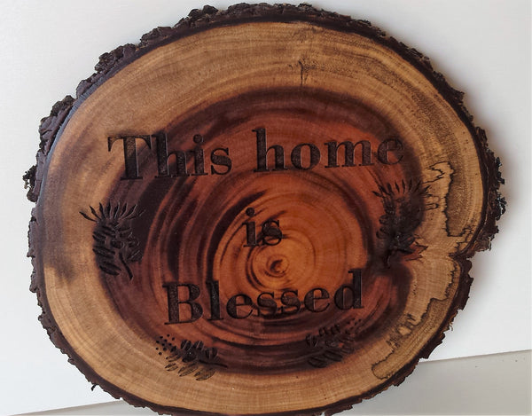 This Home Is Blessed koa branch wall hanging.