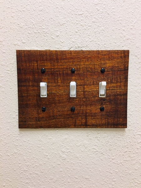 Koa wood, triple light switch cover for standard three toggle switch.