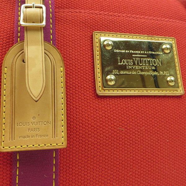 Shop Louis Vuitton Antiqua Sac We Rouge Duffle at Luxury Mart Australia Sydney. tag and metal LV plate