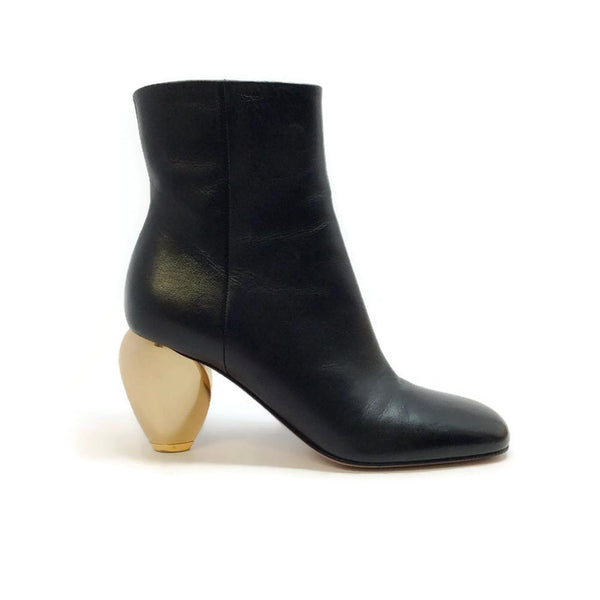 Gold Heel Bootie by Valentino outside