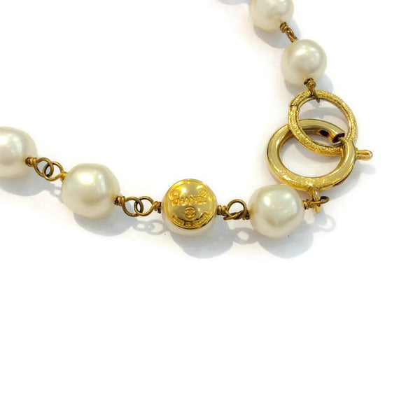 Vintage Pearl Necklace by Chanel logo