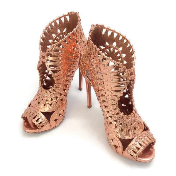 Studded Cage Sandals by Alaïa pair