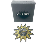 Chanel Black and Gold Glitter Resin Sun Logo Brooch