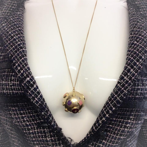Gold Toned Sphere Pendant by Chanel on mannequin