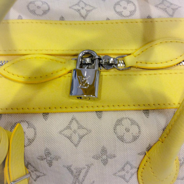 Limited Edition Jaune Monogram Denim Speedy Round Cross Body Bag by Louis Vuitton zipper