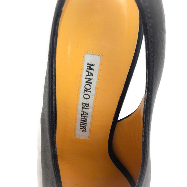 Button Slingback Black Pumps by Manolo Blahnik logo