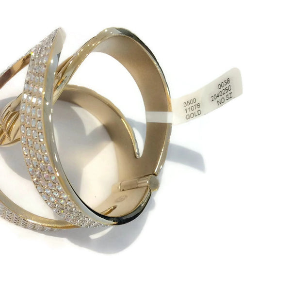Gold Tone and Crystal Interlocking CC Hinge Bracelet by Chanel tag
