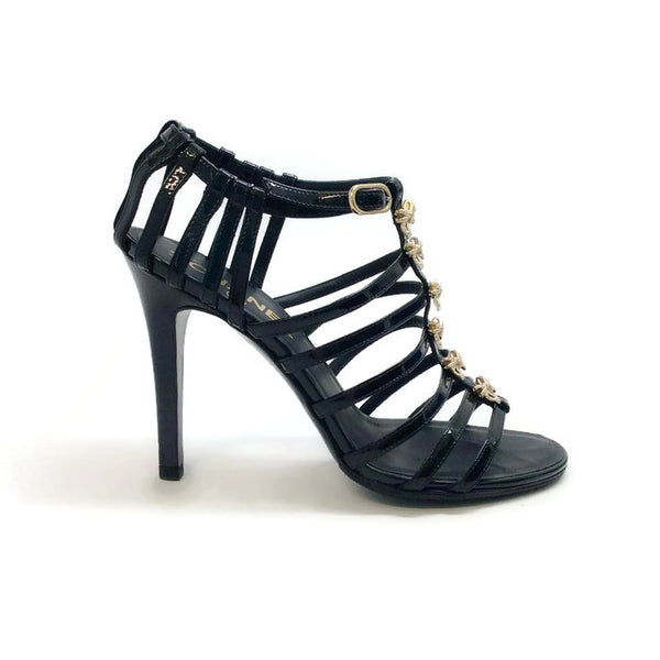 Bow Embellished Cage Sandals by Chanel outside