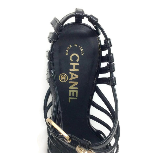 Bow Embellished Cage Sandals by Chanel logo