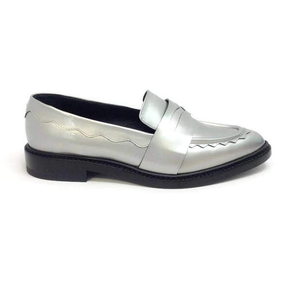 Silver Pointy Penny Loafer Flats by Christopher Kane outside