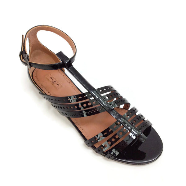 ALAÏA Black Patent Laser Cut Gladiator Flat Sandals