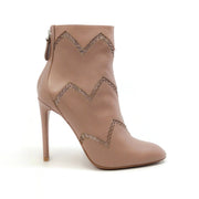 ALAÏA Nude Cut Out Ankle Boots