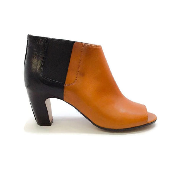 Peep Toe Black / Brown Booties by Maison Margiela outside