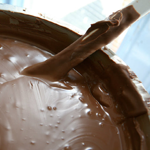Big vat of chocolate mixing