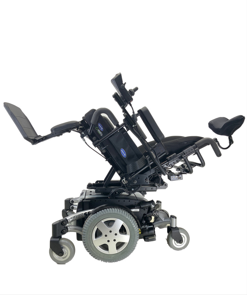 Tilted view of Like New Invacare TDX SP Rehab Power Chair | 17 x 20 Seat | Tilt & Seat Elevate