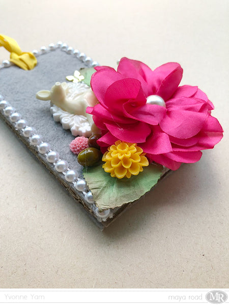 An embellished tag by Yvonne Yam for Maya Road