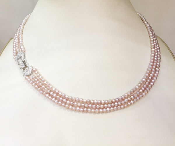 Vintage-Style Three Strand Genuine Pink Pearl Necklace,vintage pearl necklace,multi-strand pearl necklace,pearl necklace with 3 strands,natural pearl necklace,bridal necklace,wedding jewelry,wedding necklaces,freshwater pearls,handmade pearl jewelry,designer jewelry for women,handmade jewelry for women, hand-knotted genuine pearl necklace