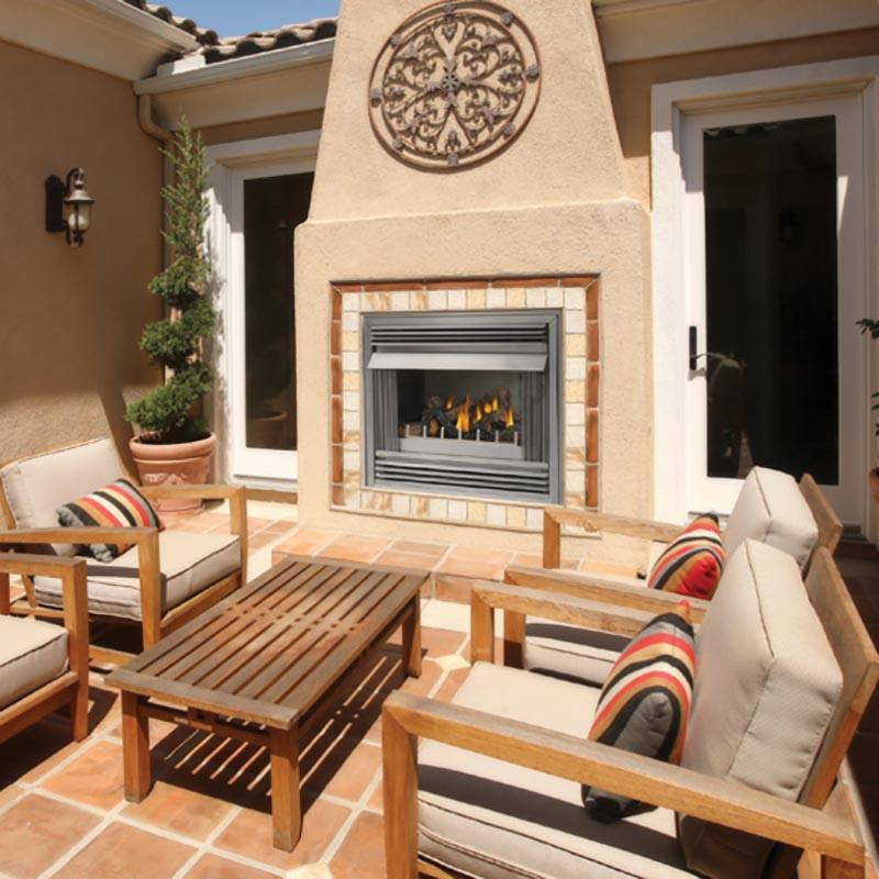 Enhance your outdoor living space with the stainless steel Riverside gas fireplace. All-weather construction