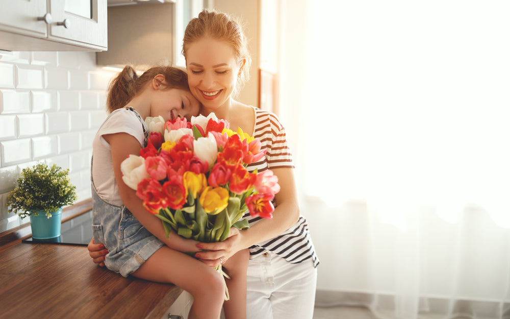 daughter and mother with flowers