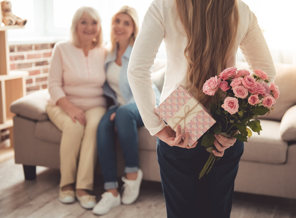 girl giving flowers for mother's day