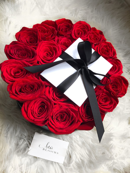 round-bloom-box,round-flower-box,black flower box, red-roses-in-round-box, flowers in a box