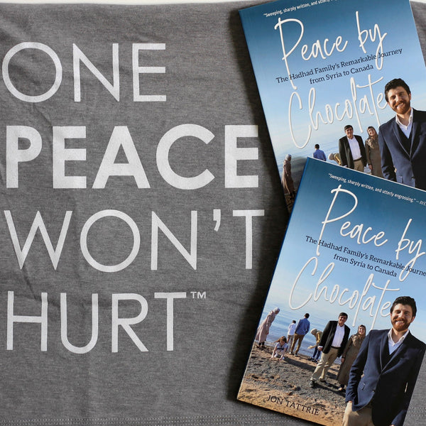 Two copies of Peace by Chocolate sit, overlapping, on a grey heather shirt. White text on the shirt reads: one peace won't hurt.