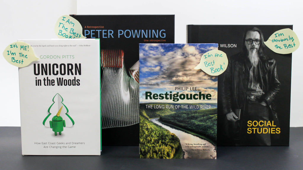 Photo of books standing upright with speech bubbles on the cover declaring they are the best book. From left to right: Unicorn in the Woods, Peter Powning, Restigouche, James Wilson