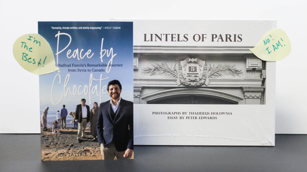 Photo of books standing upright with speech bubbles on the cover declaring they are the best book. From left to right: Peace by Chocolate, Lintels of Paris