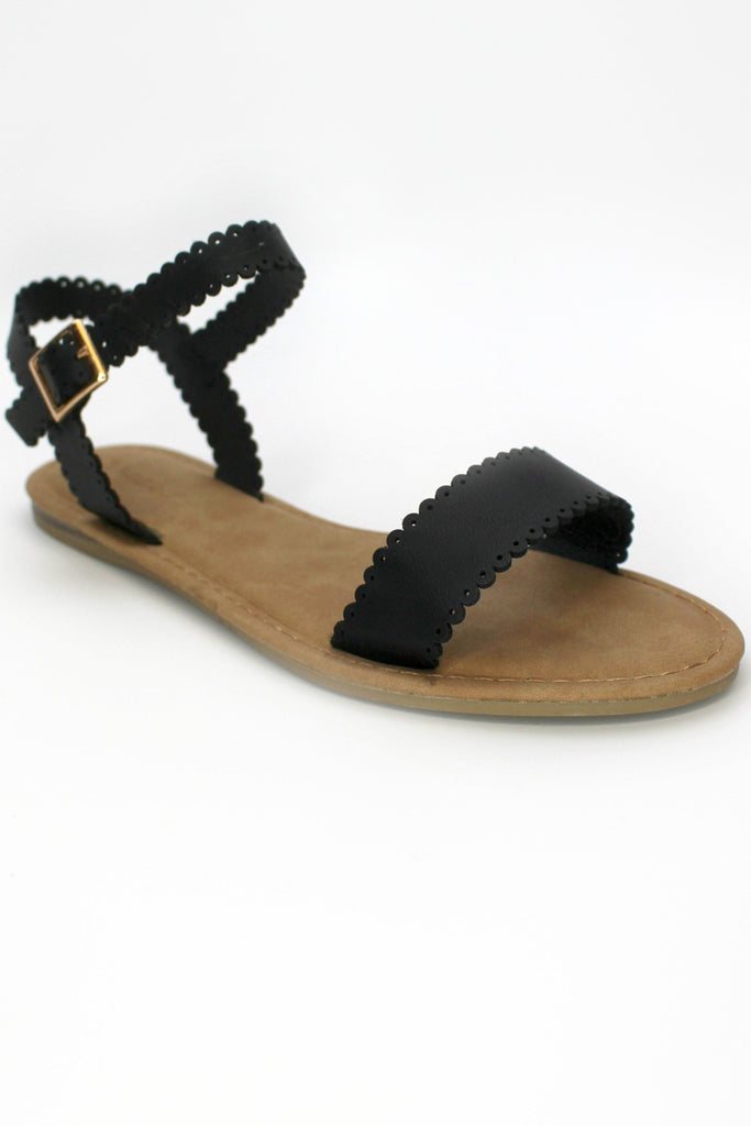 scalloped black sandals