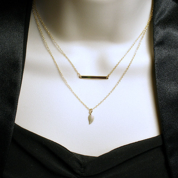 gold layered necklace bar leaf