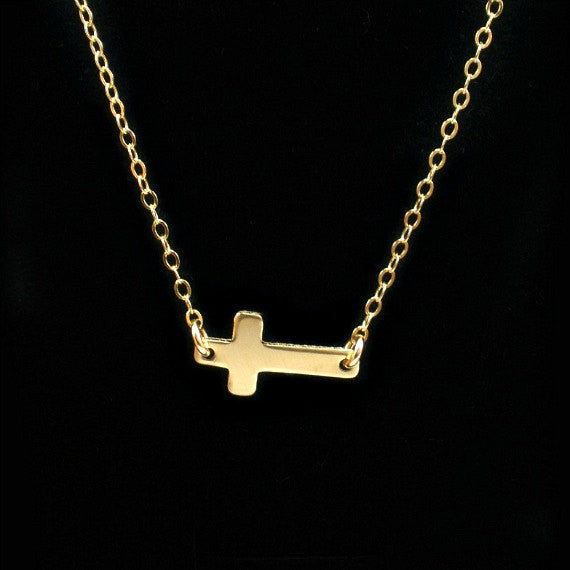 gold sideways cross necklace simple minimal
