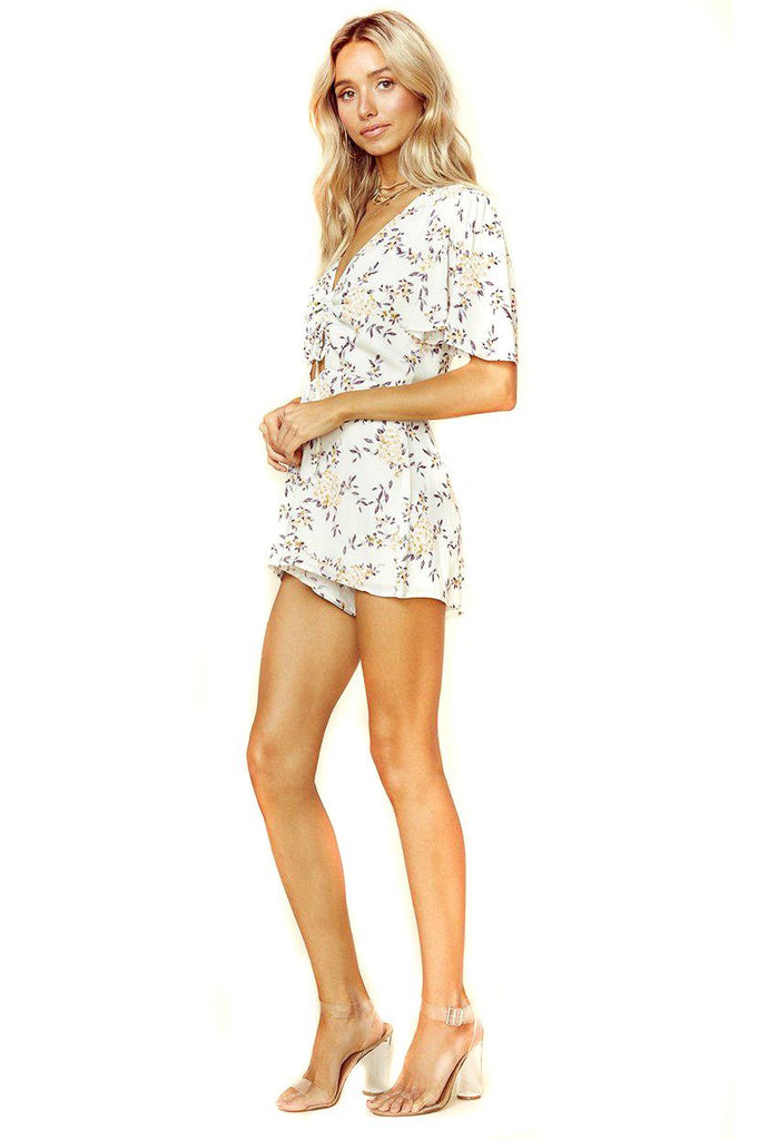 cream floral short-sleeve romper with front cutout