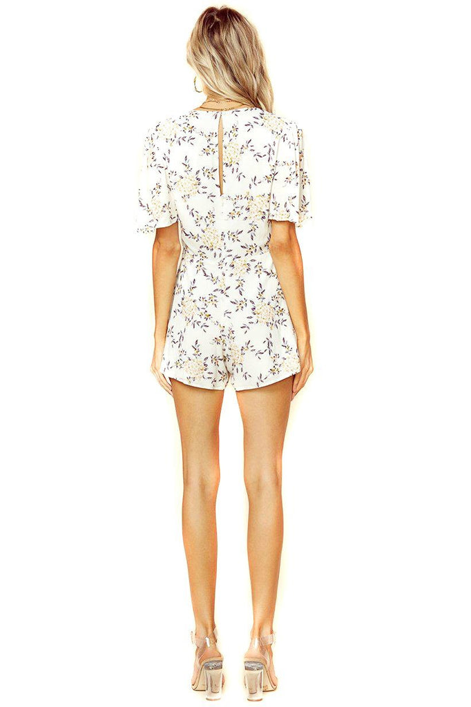 cream blossom yari romper with keyhole back detail