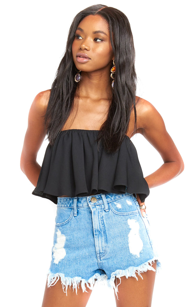 Black Heidi Ruffle Crop Top worn strapless