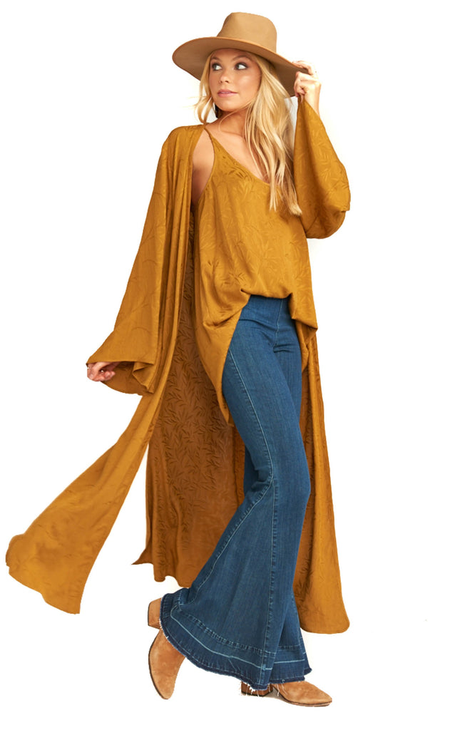 Show Me Your Mumu gold kimono flowing behind walking model