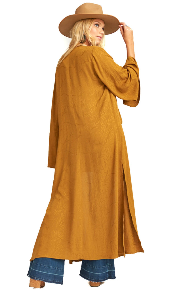 back of long gold kimono draped over model