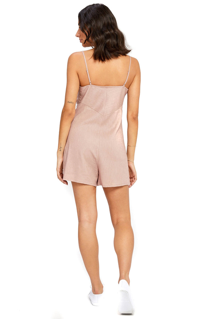 gentle fawn rose romper and white sneakers back photo
