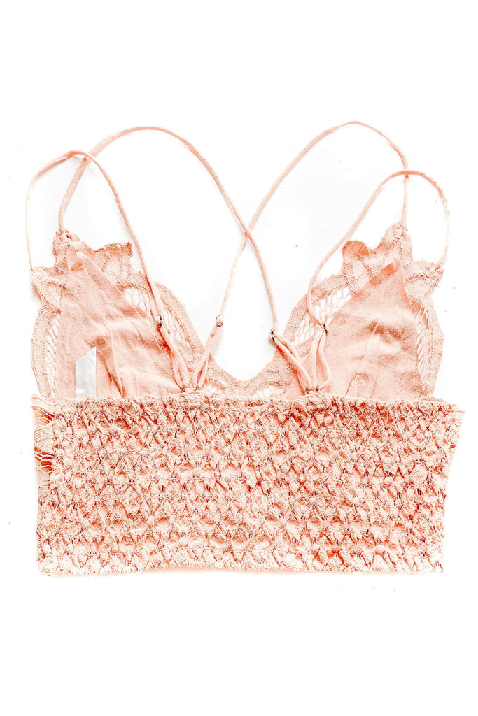 free people light orange lace bralette with criss cross straps